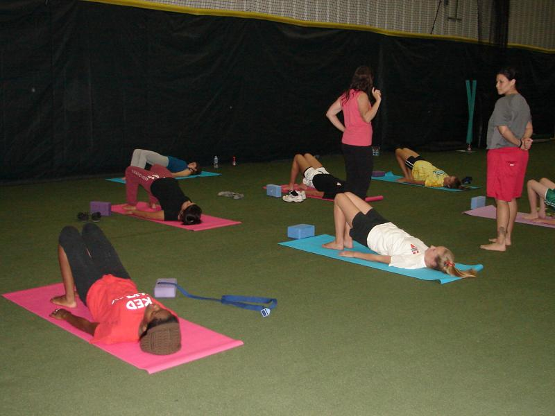Rosabeth teaching Softball athletes Sport Specific yoga at Pitchafit